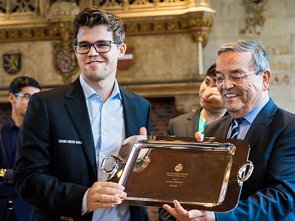 Magnus Carlsen wins Leuven with three-point lead